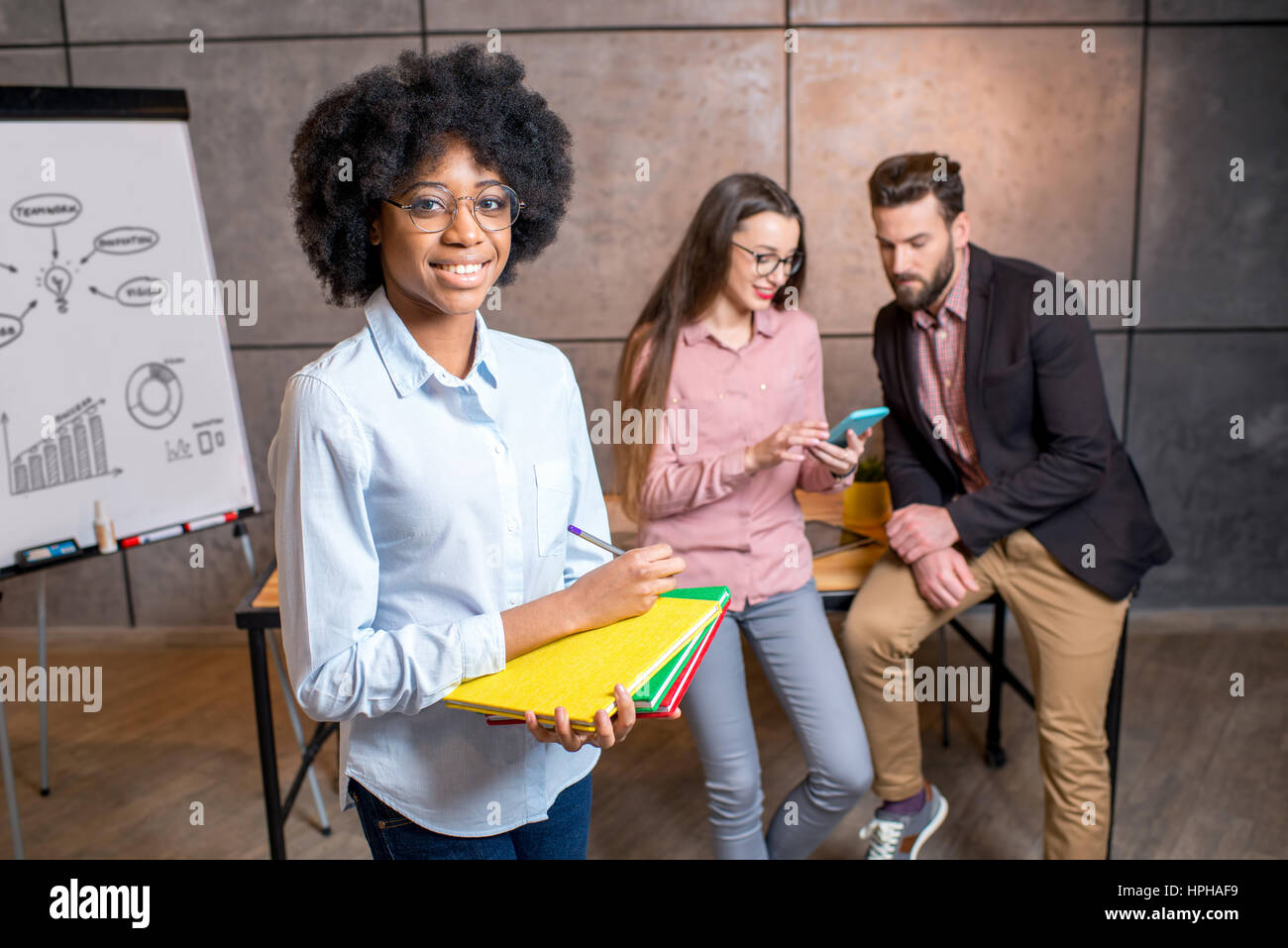 Woman's portrait with coworkers - Stock Image