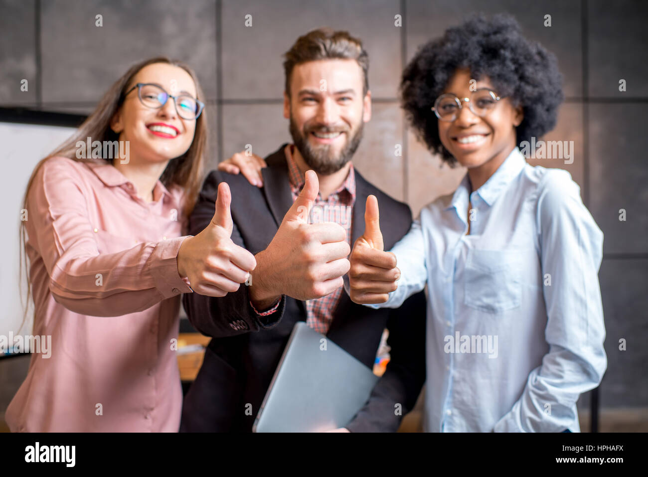Portrait of multi ethnic coworkers - Stock Image