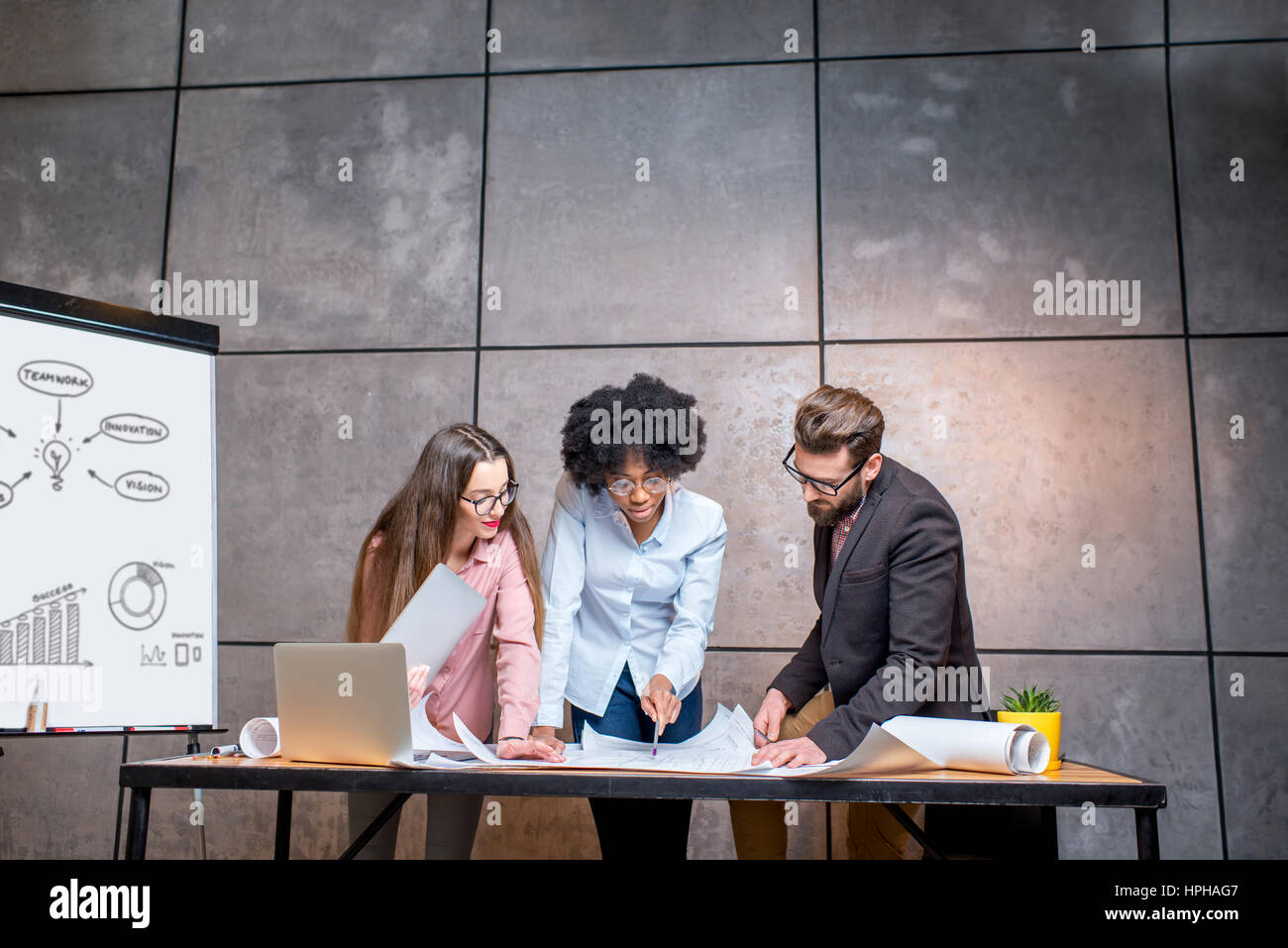 Architects working at the office - Stock Image