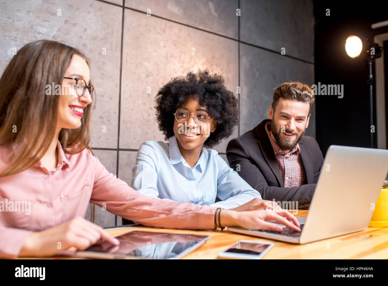 Coworkers at the office - Stock Image