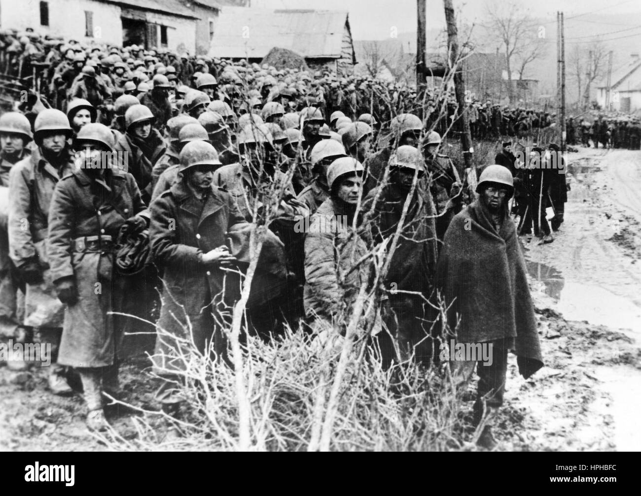 The Nazi propaganda image shows US-American soldiers after being taken prisoner by the German Wehrmacht on the Western - Stock Image