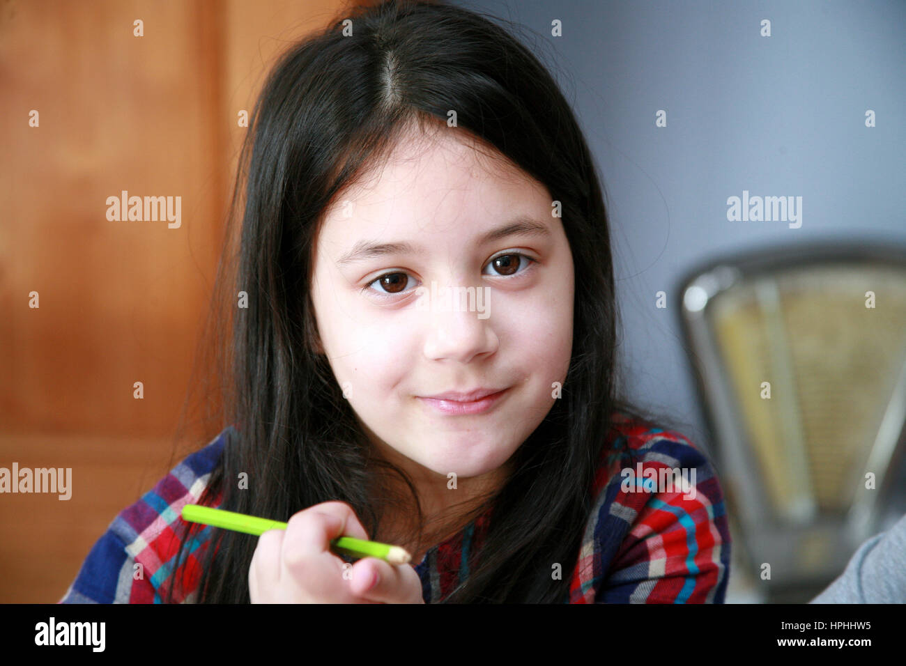 young girl smiling at camera - Stock Image
