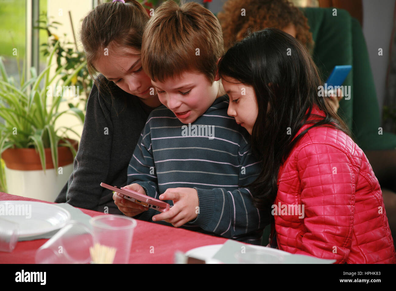 Kids playing on a game console - Stock Image
