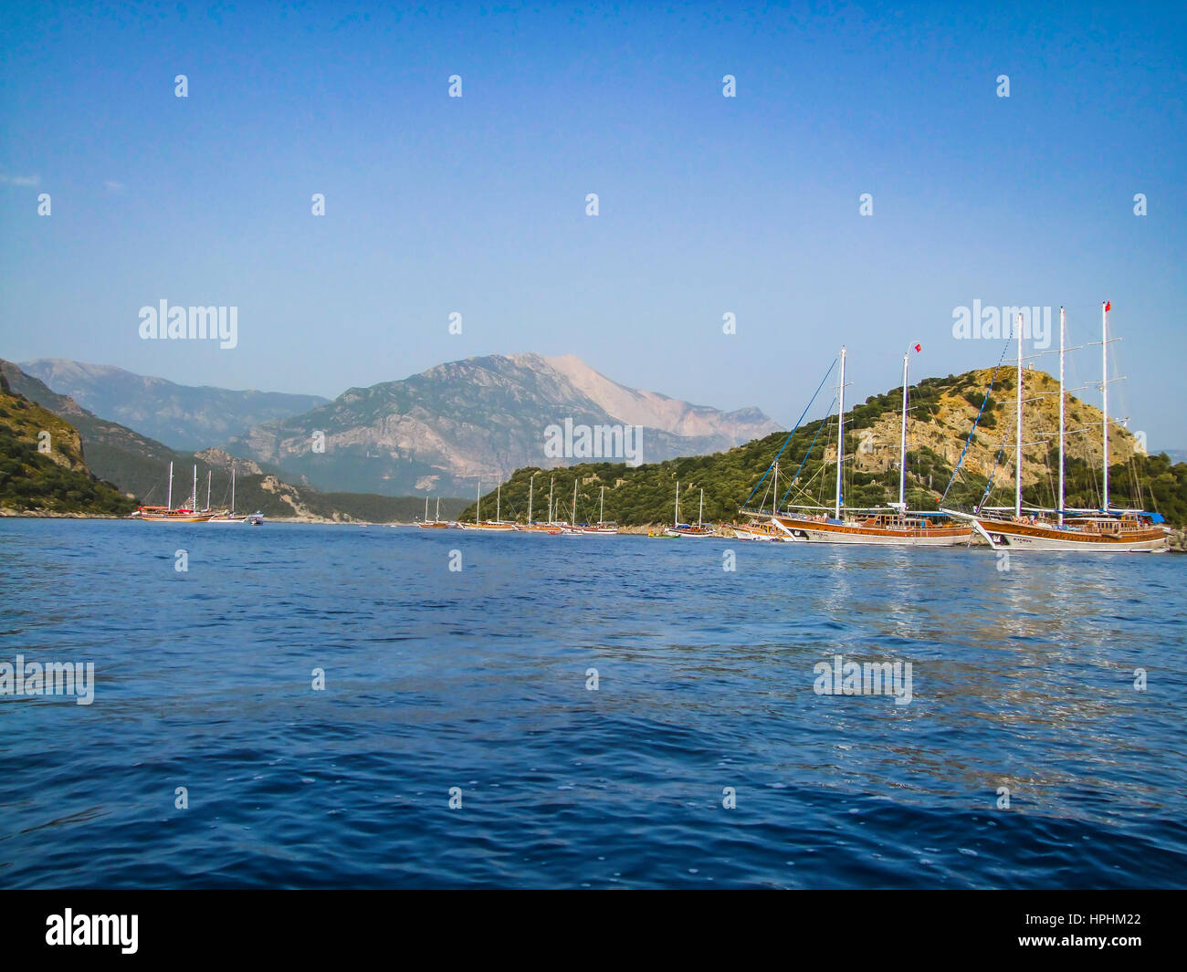 Yacht cruise Fethiye Turkey,private yacht  cruising,boats anchored by the island, mavi yolculuk,ozel tekne, adaya - Stock Image