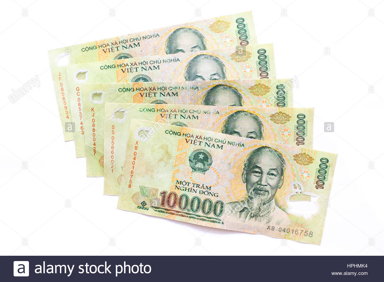 Vietnamese Dong currency, 100,000 dong banknontes money - Stock Image