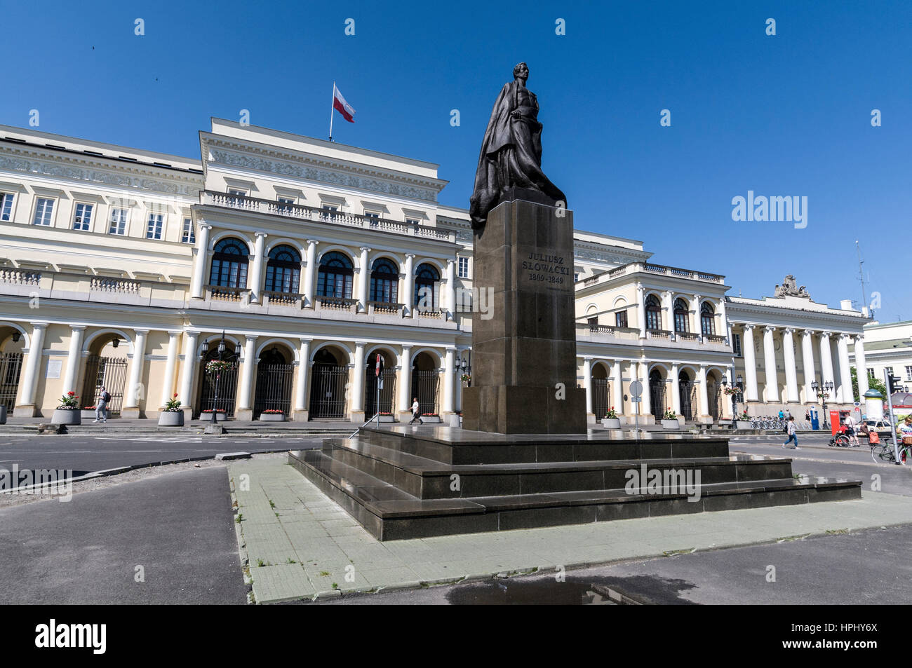 A monument of the Polish poet, Juliusz Slowacki in front of the Palace of the Ministry of Revenues and Treasury Stock Photo