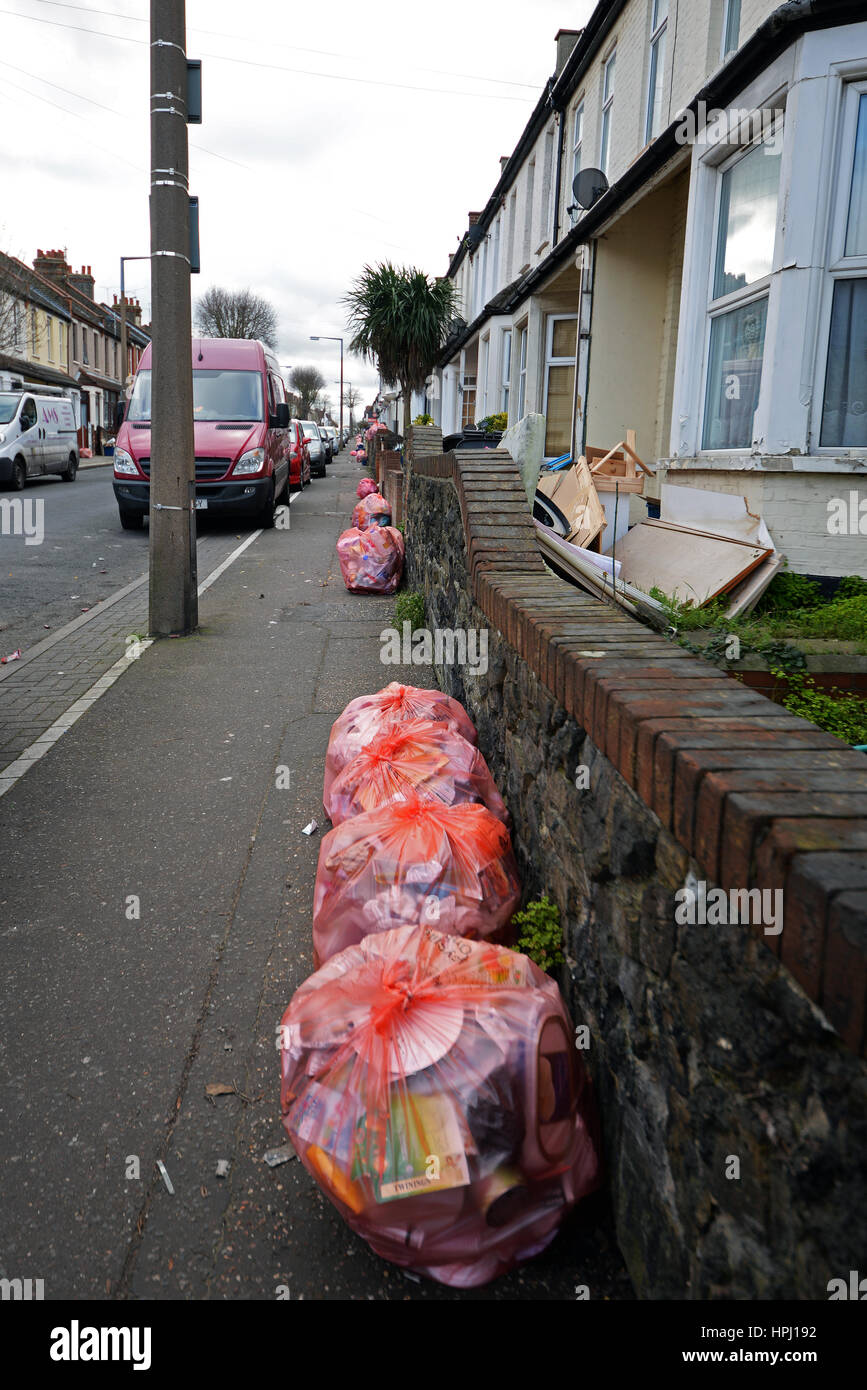 Recycling bags lined up outside houses on Hainault Avenue, Westcliff on Sea, Essex, in the Southend Borough Council - Stock Image