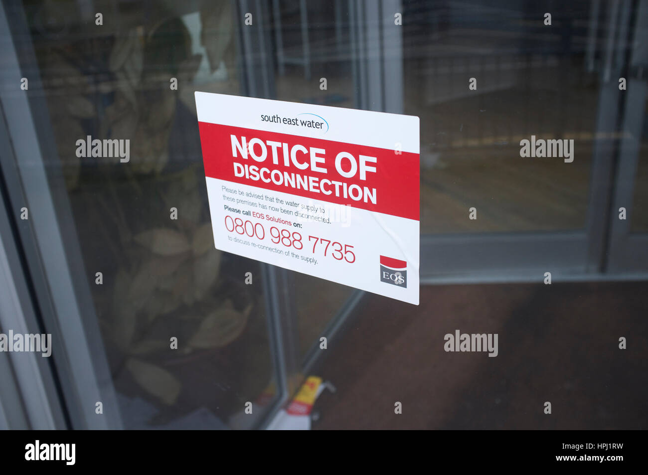 Notice of disconnection of water supply from South East Water affixed to a property - Stock Image