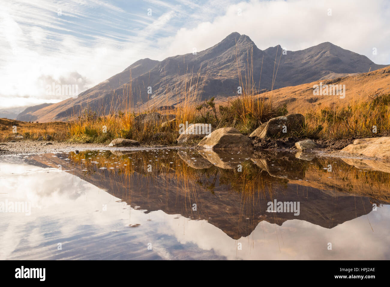 The Cuillins - Sgurr nan Gillean, Glen Sligachan, Isle of Skye, Scotland - reflected in puddle on footpath in autumn - Stock Image