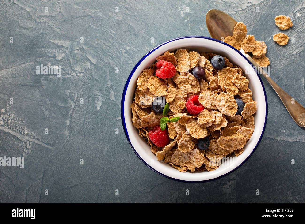 Multigrain wholewheat healthy cereals with fresh berry for breakfast overhead shot with copyspace Stock Photo