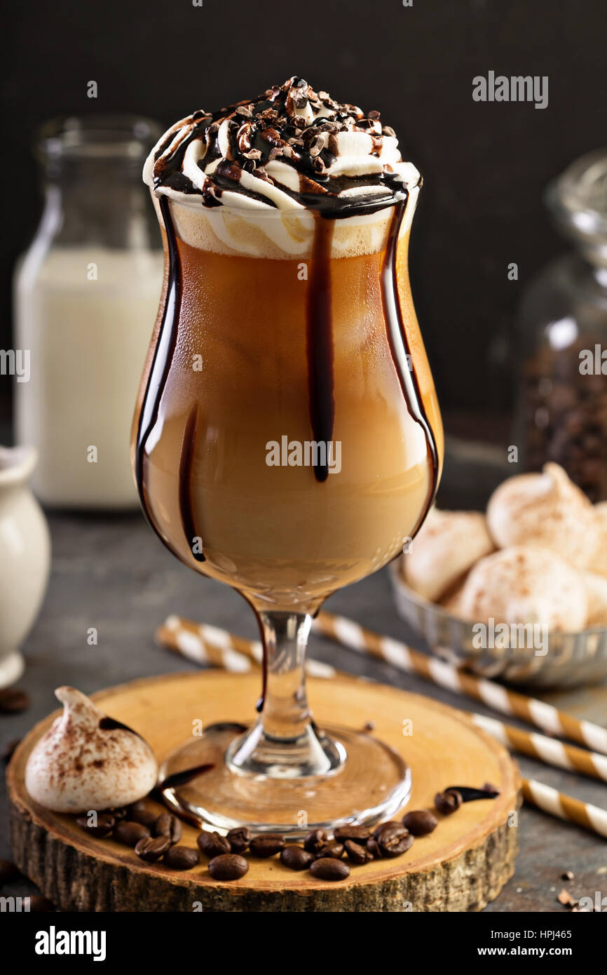 iced coffee with whipped cream and chocolate syrup stock