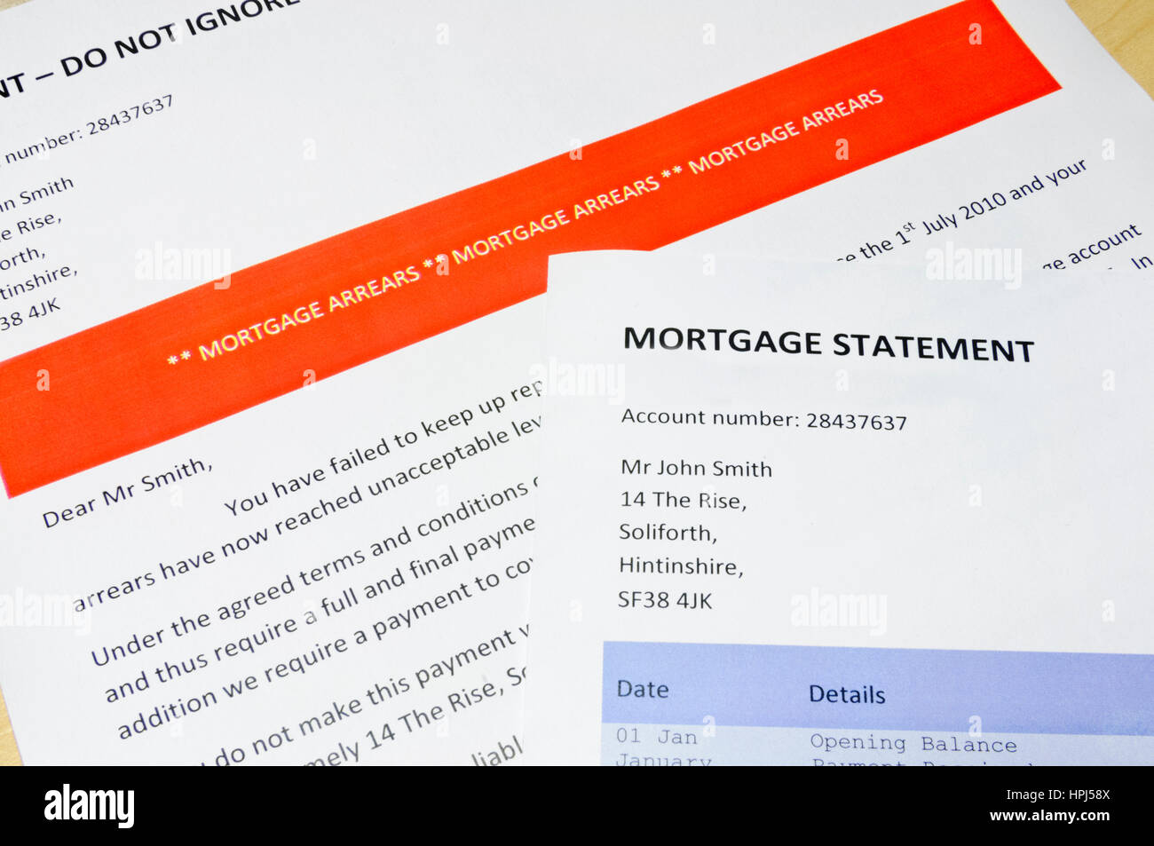 Bank letter informing customer of Mortgage Arrears and repossession  with statement showing 'Defaulted'/non - Stock Image