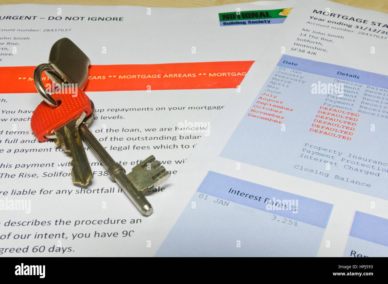 House keys on a bank letter informing customer of Mortgage Arrears and repossession  with bank statement - Stock Image