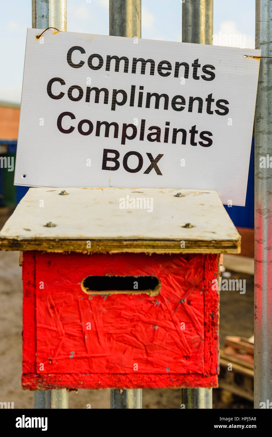 Comments, Compliments and Complaints box on the fence outside of a business. - Stock Image
