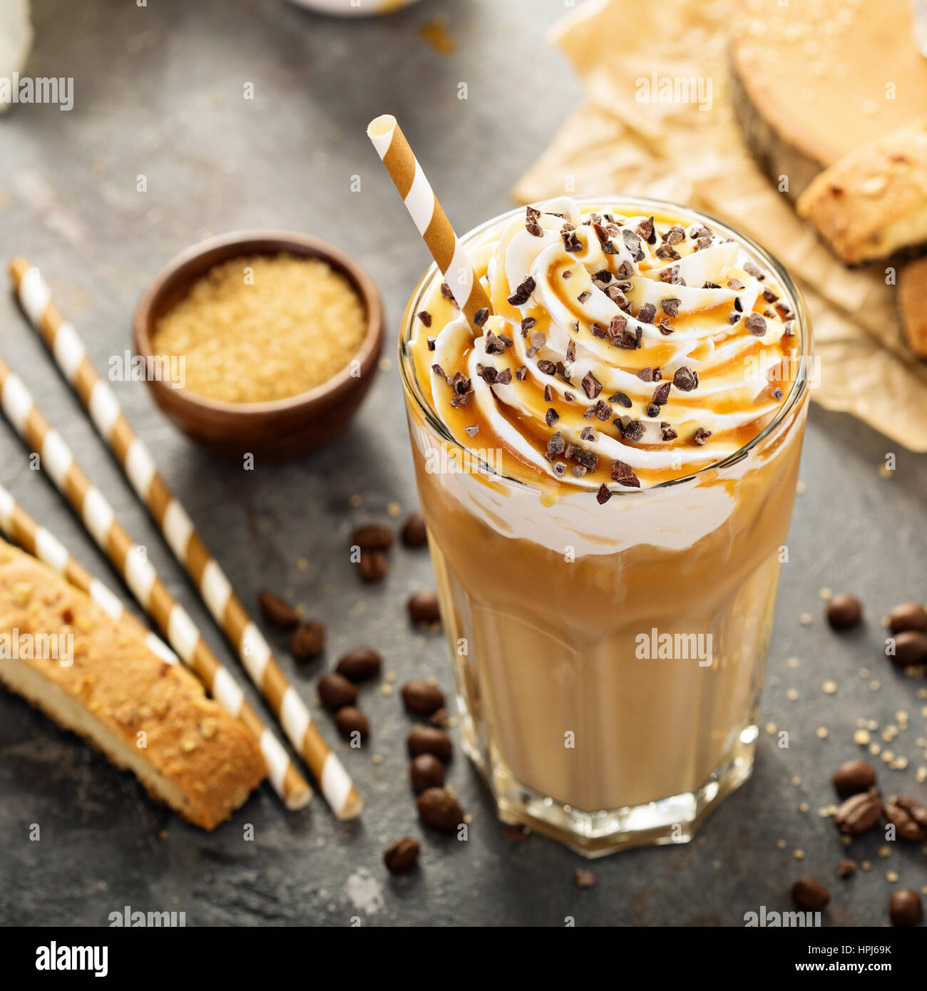iced caramel latte coffee in a tall glass with syrup and whipped stock photo 134395119 alamy. Black Bedroom Furniture Sets. Home Design Ideas