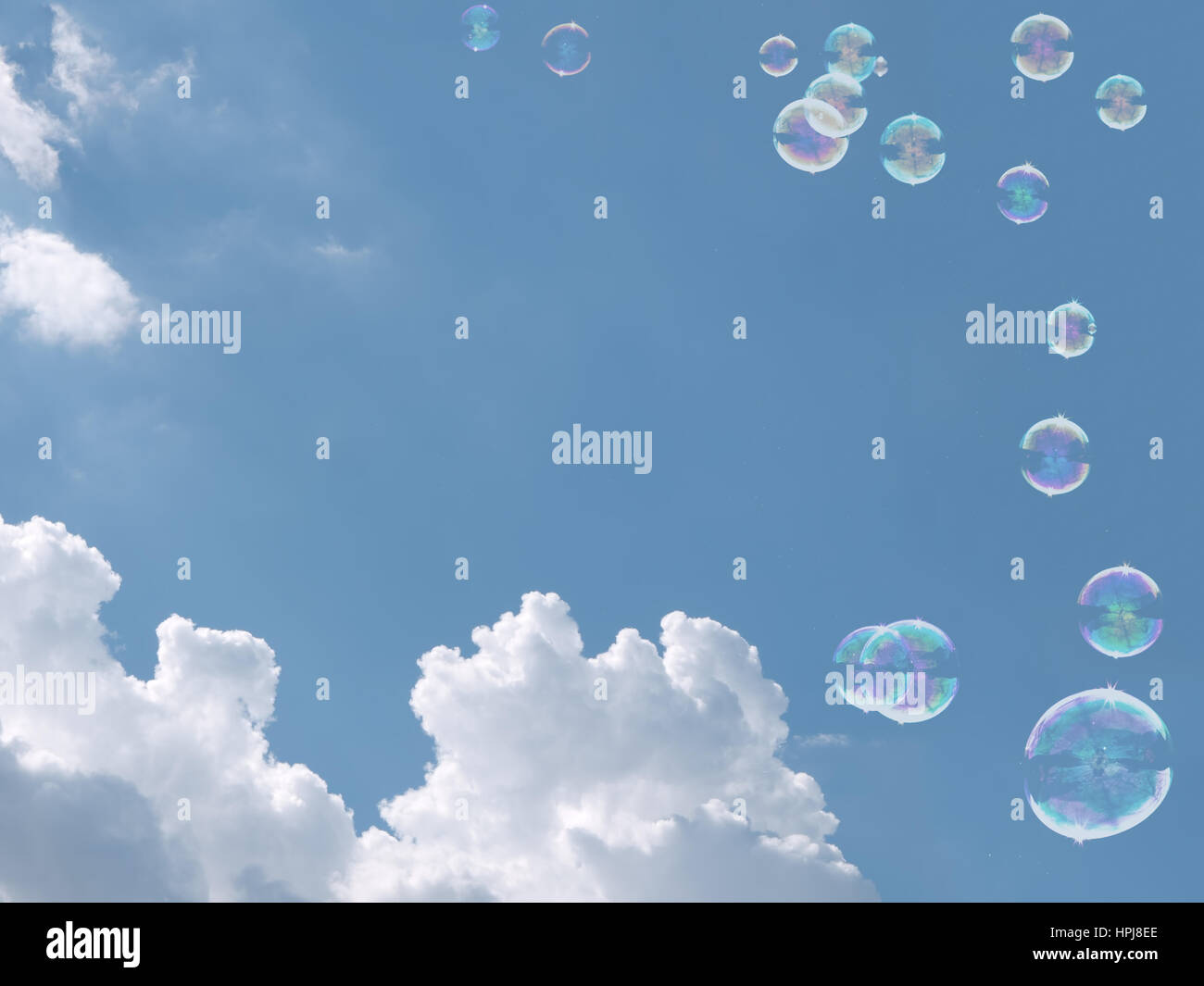 Soap bubbles and sky background. Memories of carefree childhood maybe. Or dreams, wishes etc concept. - Stock Image