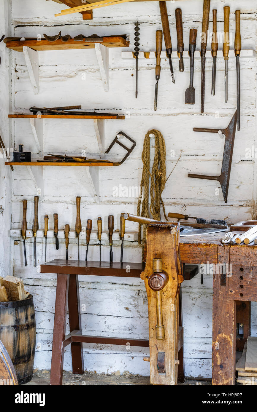 Vintage carpentry tools hanging on wall. - Stock Image
