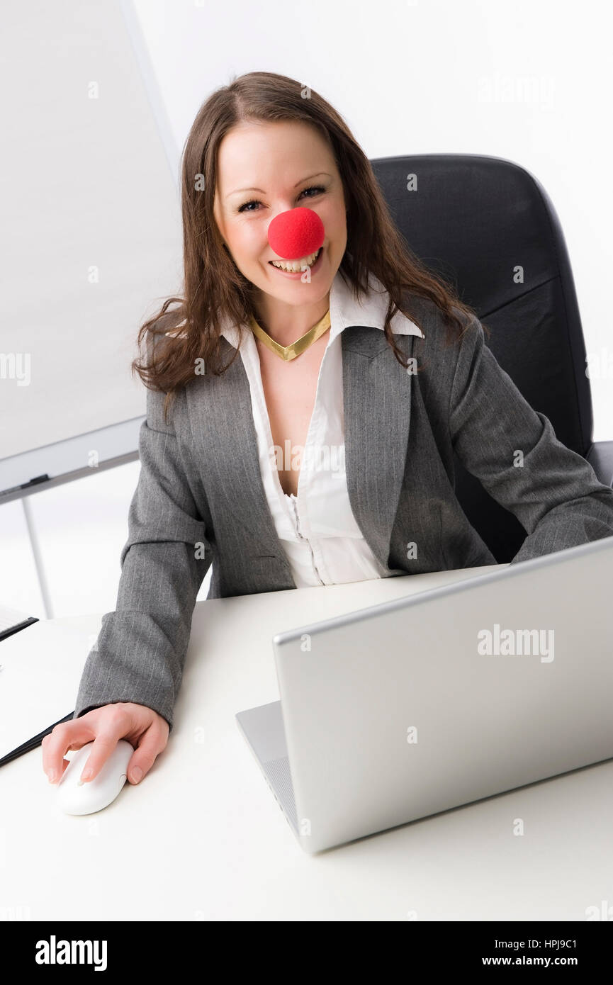 Model released , Geschaeftsfrau mit roter Clownnase - business woman with red nose Stock Photo
