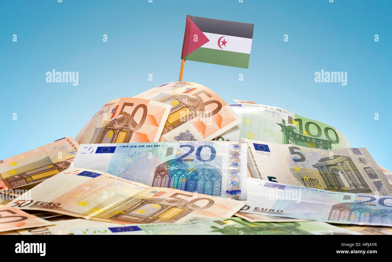 The national flag of Western Sahara sticking in a pile of mixed european banknotes.(series) - Stock Image