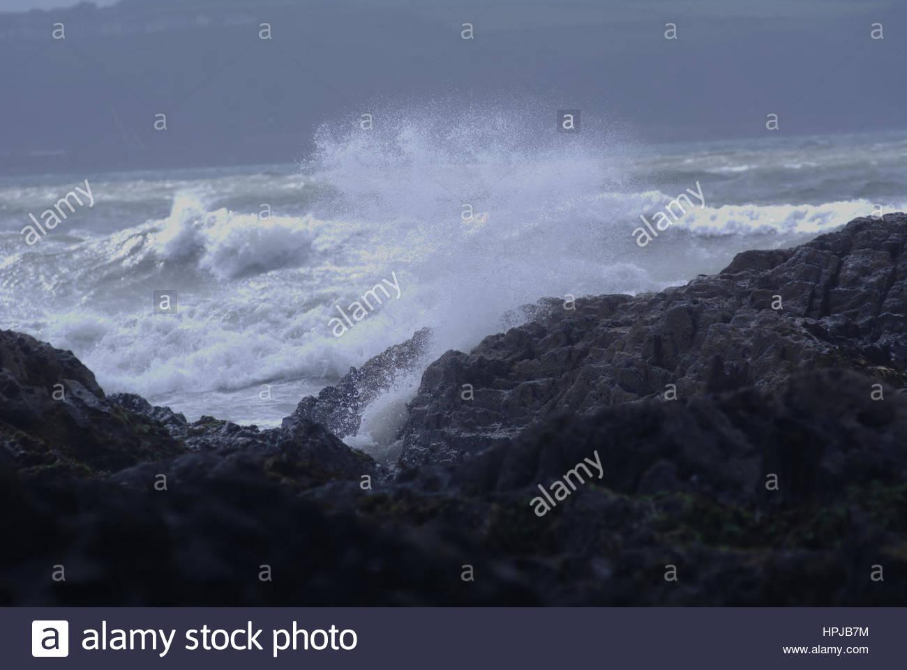 Coastal waves crashing into rocks during a storm - Stock Image