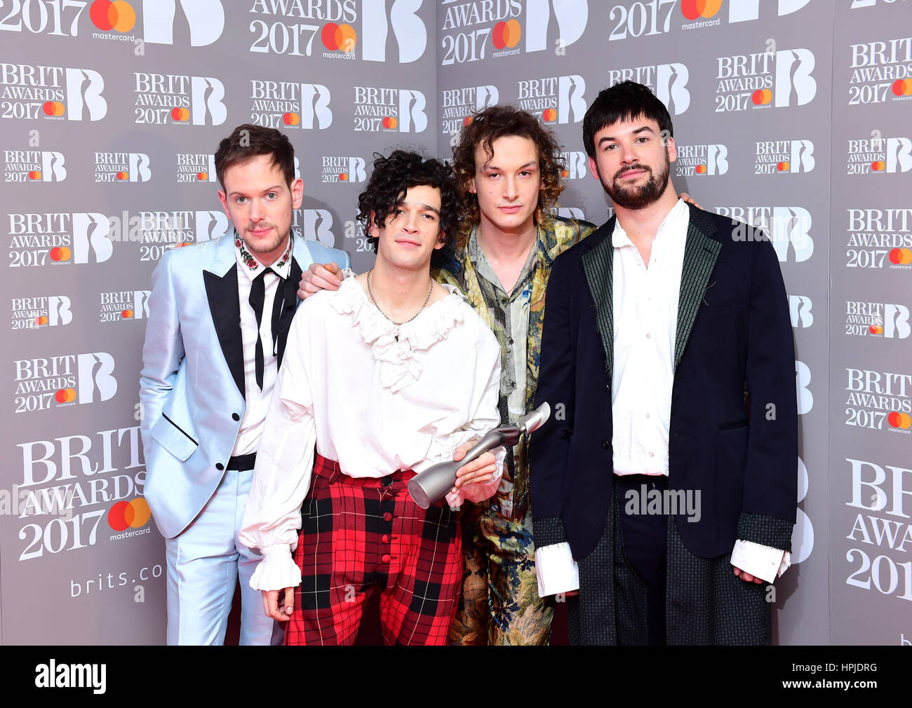The 1975's Adam Hann (L - R), George Daniel, Ross MacDonald and Matthew Healy with the Best British Group Award - Stock Image