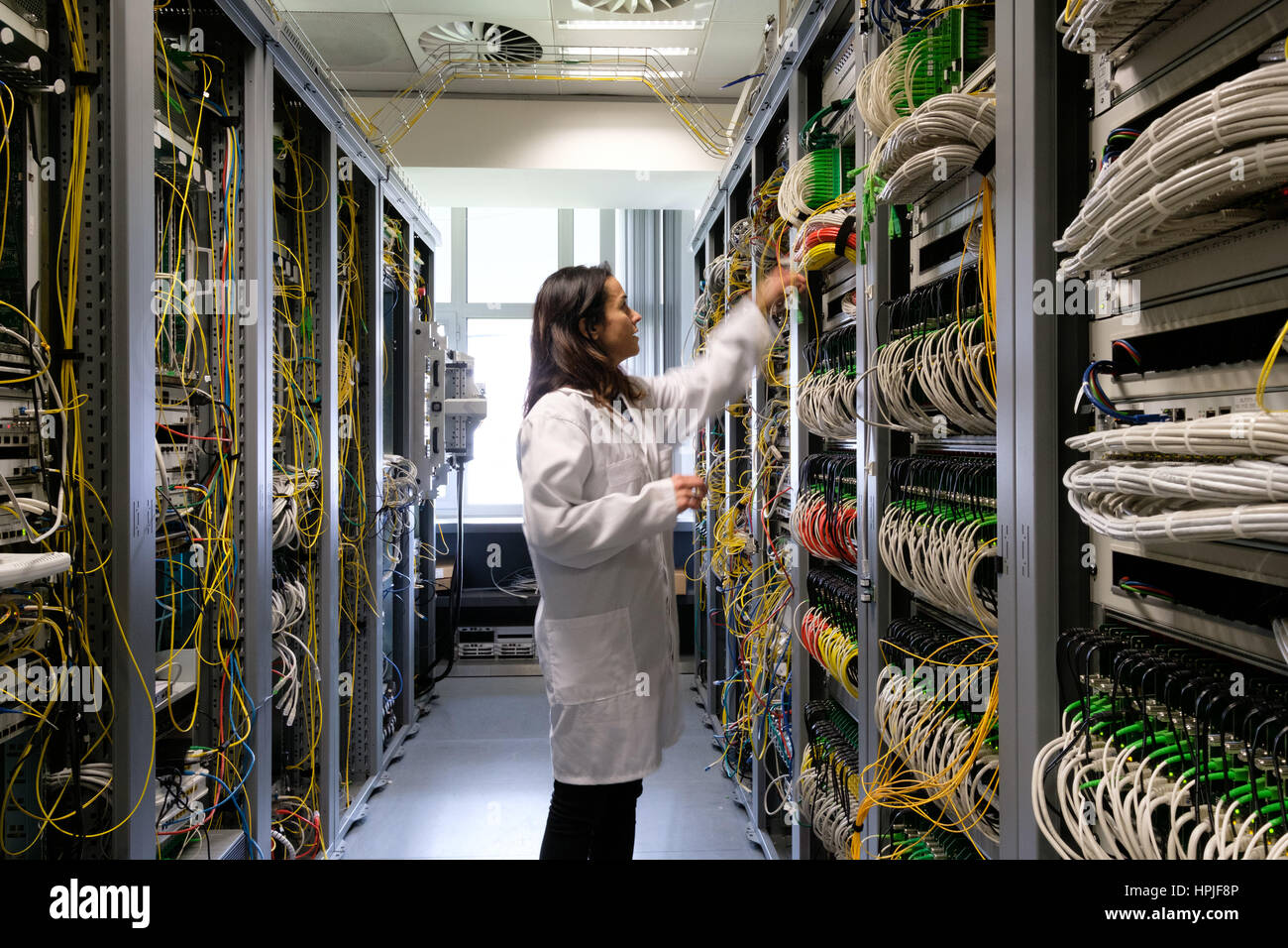 Data center technician working in the server room - Stock Image