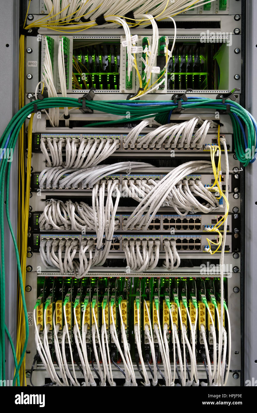 Detail of cable management on a data centre server room - Stock Image