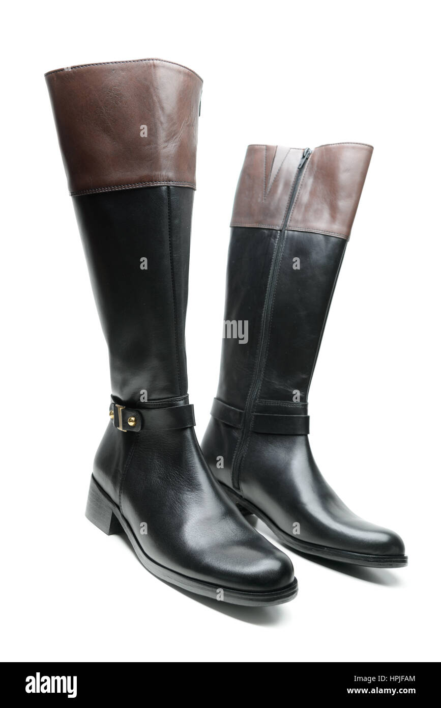 Pair of leather riding boots cut out isolated on white background - Stock Image
