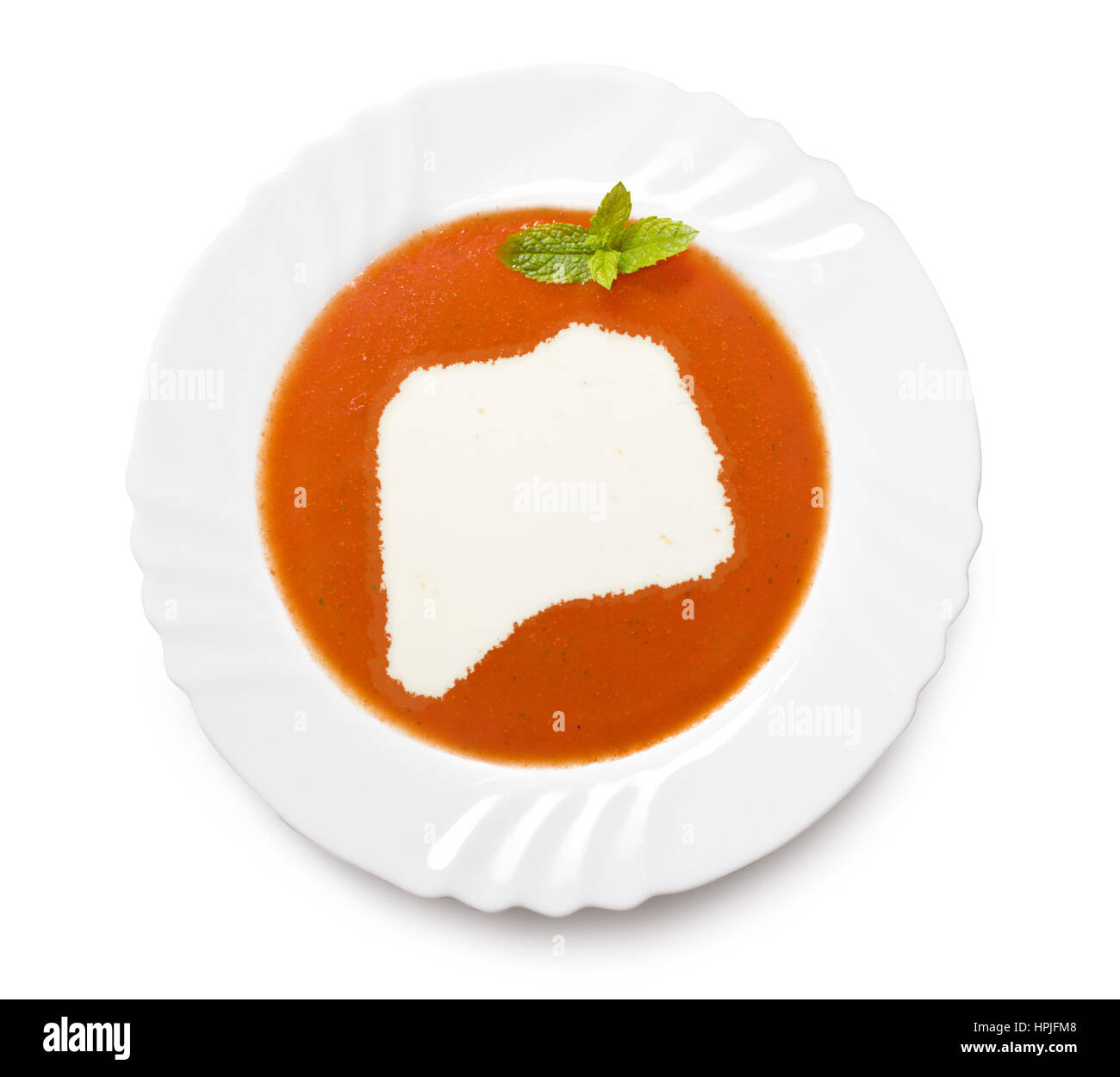 A plate tomato soup with cream in the shape of Rwanda.(series) - Stock Image