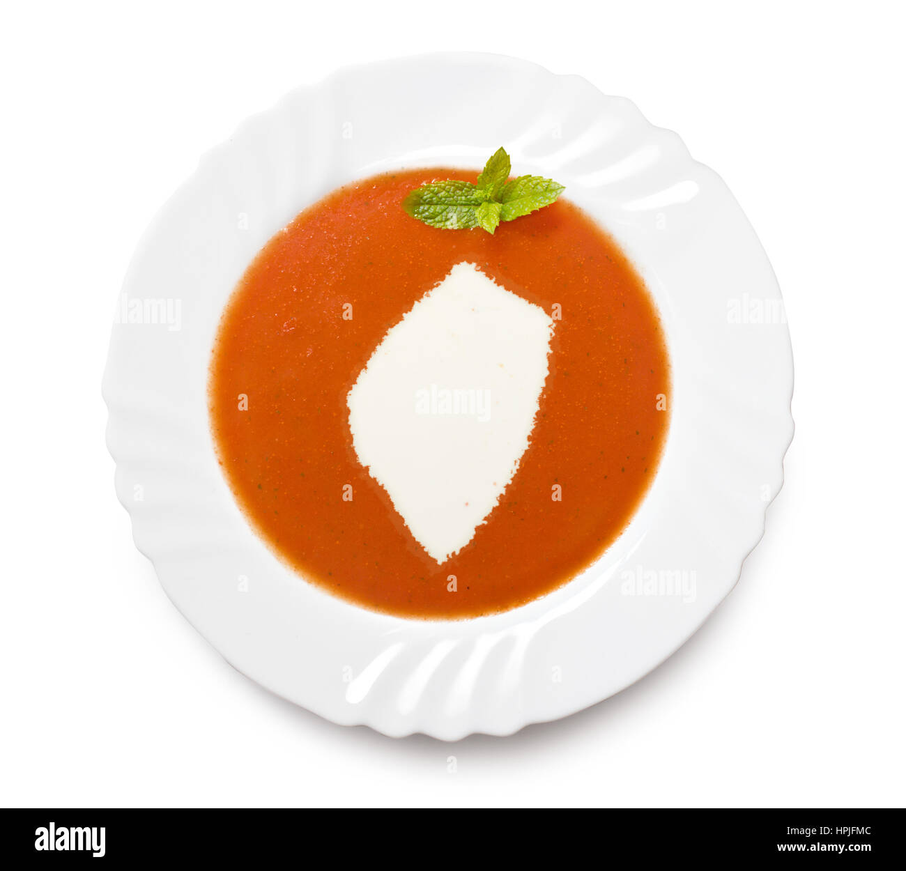 A plate tomato soup with cream in the shape of Swaziland.(series) Stock Photo