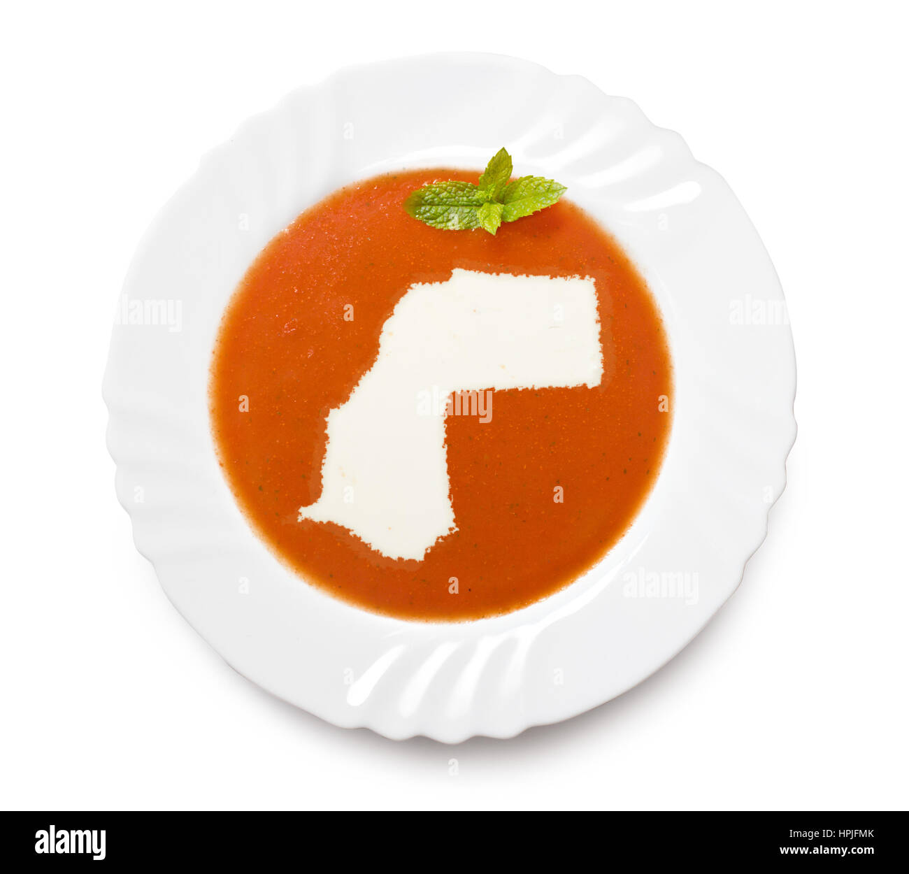 A plate tomato soup with cream in the shape of Western Sahara.(series) - Stock Image