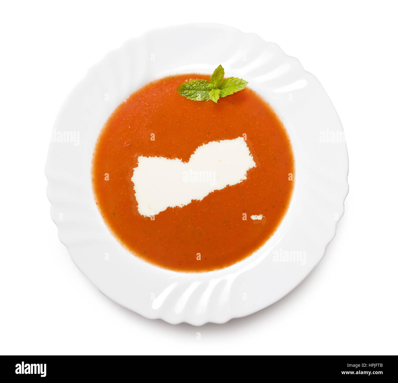 A plate tomato soup with cream in the shape of Yemen.(series) - Stock Image