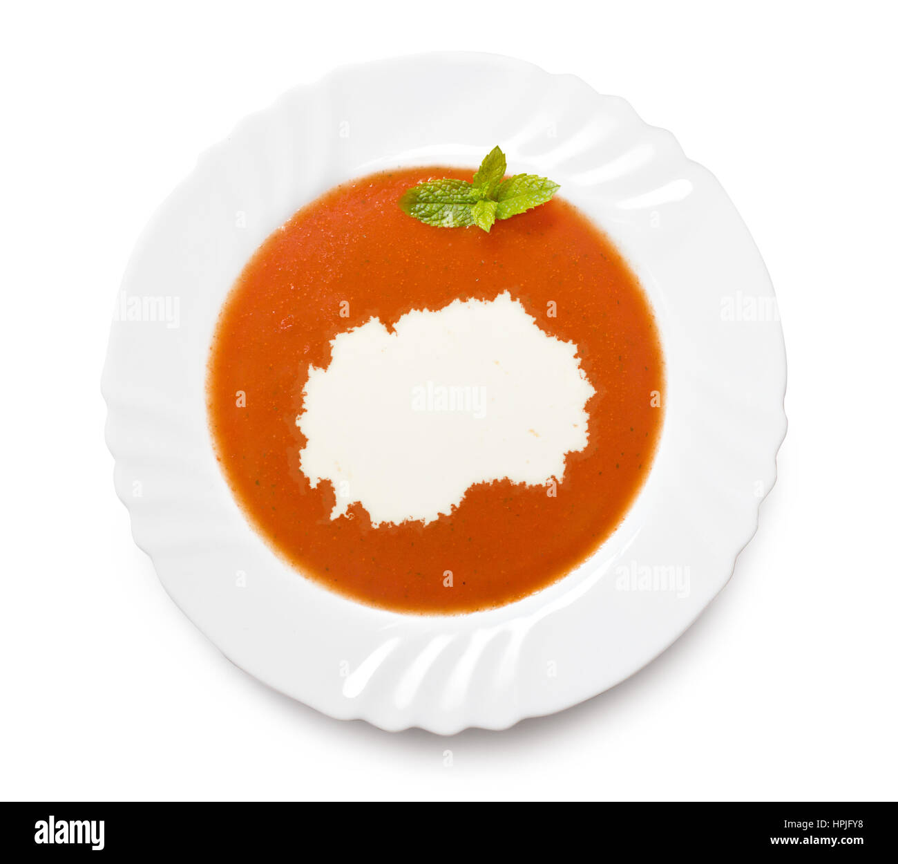 A plate tomato soup with cream in the shape of Macedonia.(series) - Stock Image
