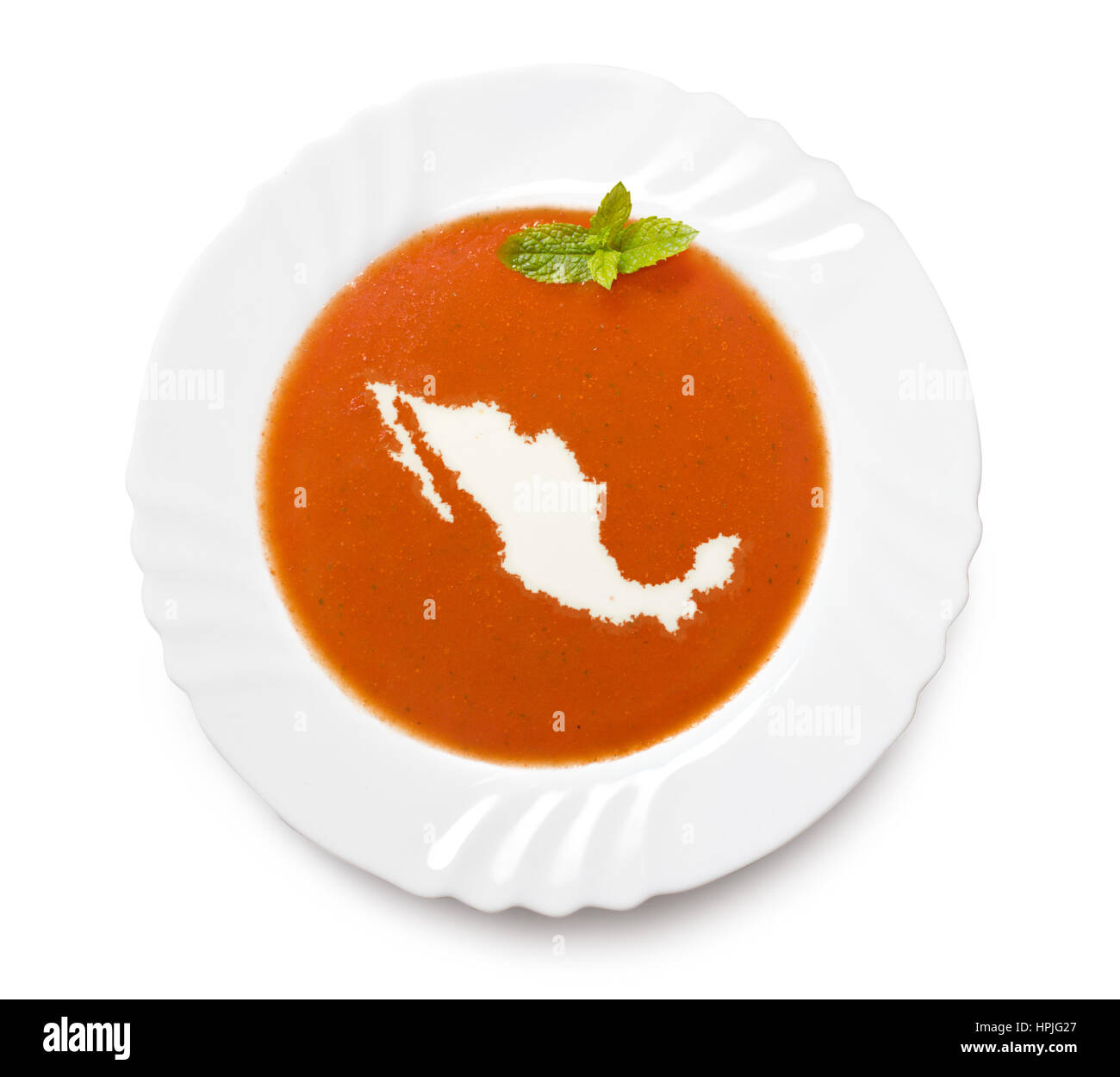 A plate tomato soup with cream in the shape of Mexico.(series) - Stock Image