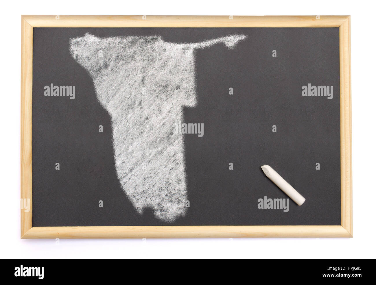 Blackboard with a chalk and the shape of Namibia drawn onto. (series) - Stock Image