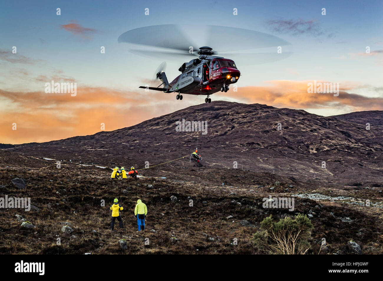 Coastguard helicopter, hovering in the air, on training exercise at Sligachan, Isle of Skye, Scotland. - Stock Image