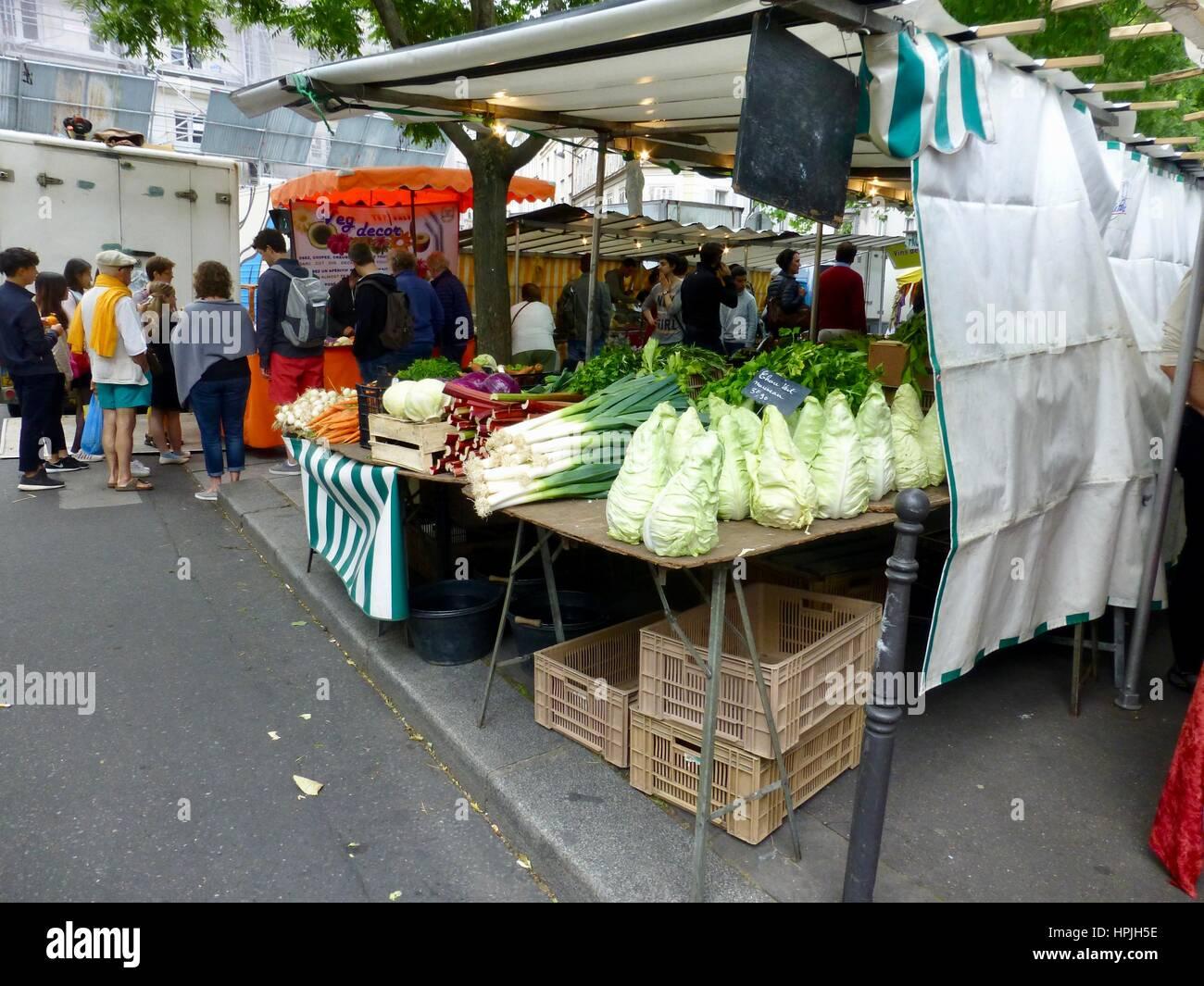 Neatly displayed vegetables at Bastille Market on Boulevard Richard Lenoir, Paris France - Stock Image
