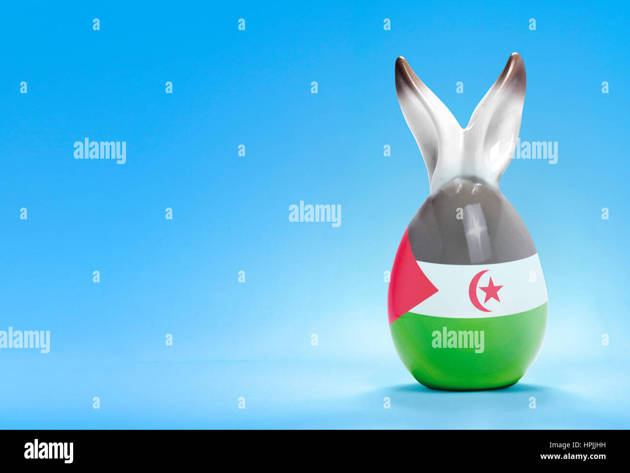 Colorful cute ceramic easter egg with rabbit ears and the flag of Western Sahara .(series) Stock Photo