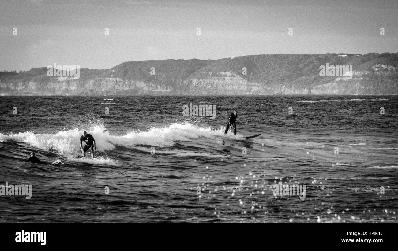 Surfers at Newcastle Beach Australia - Stock Image