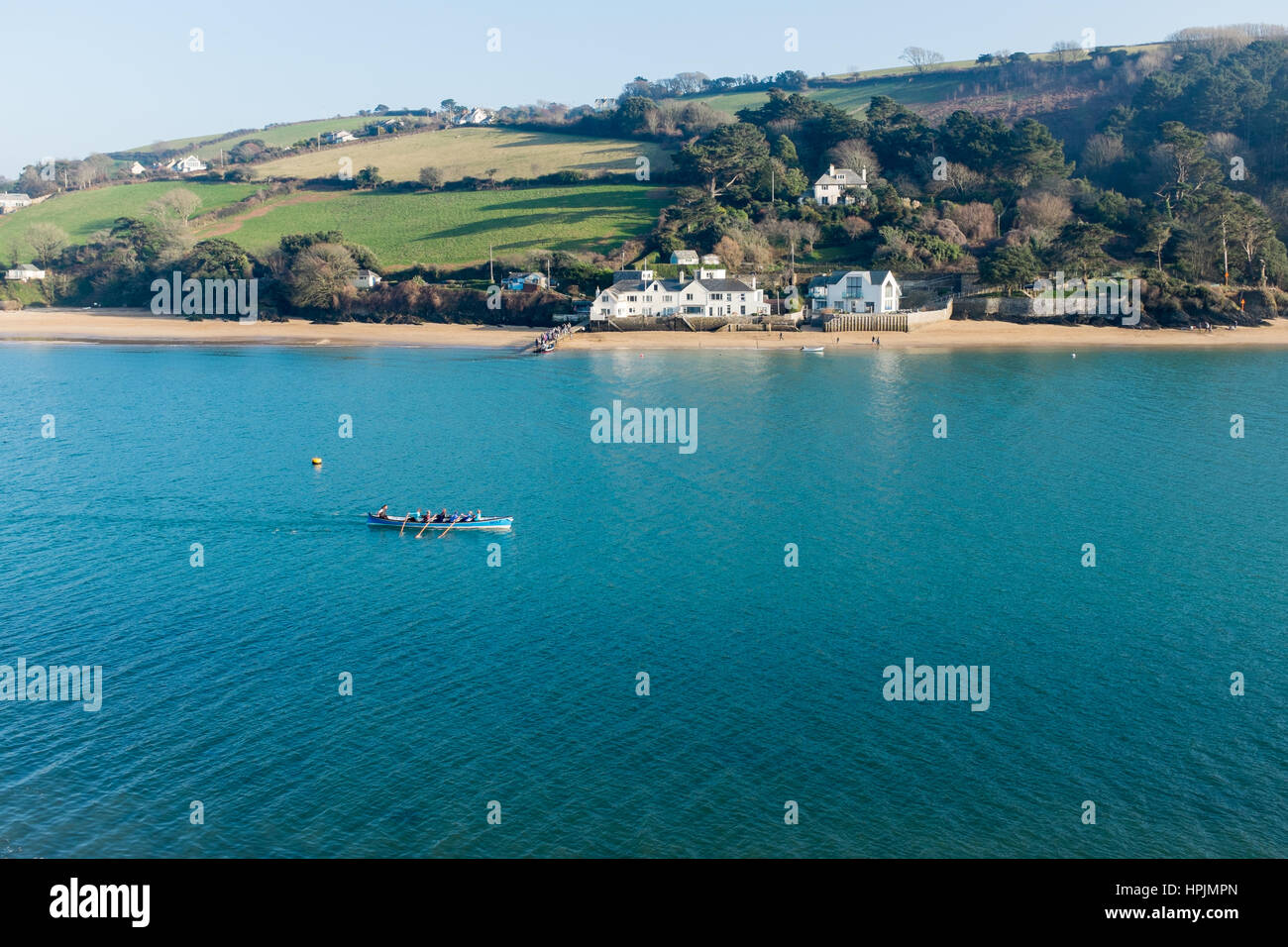Gig boat being rowed on the Salcombe Estuary in winter - Stock Image