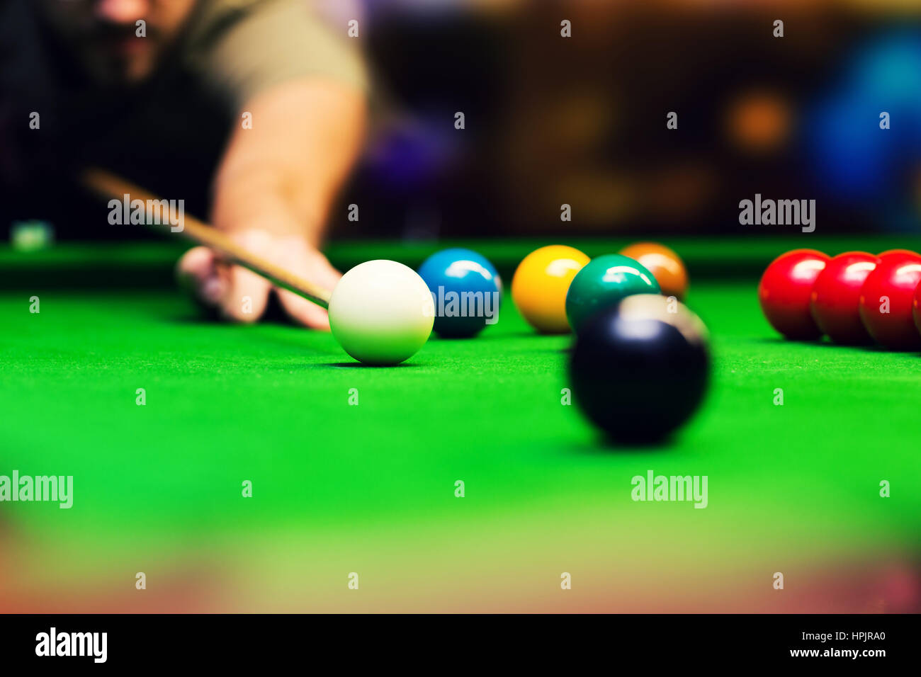 playing snooker - man aiming the cue ball - Stock Image