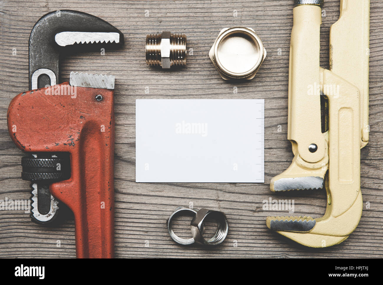 Pipes Plumbing Tools Fittings And Business Card On The Wooden