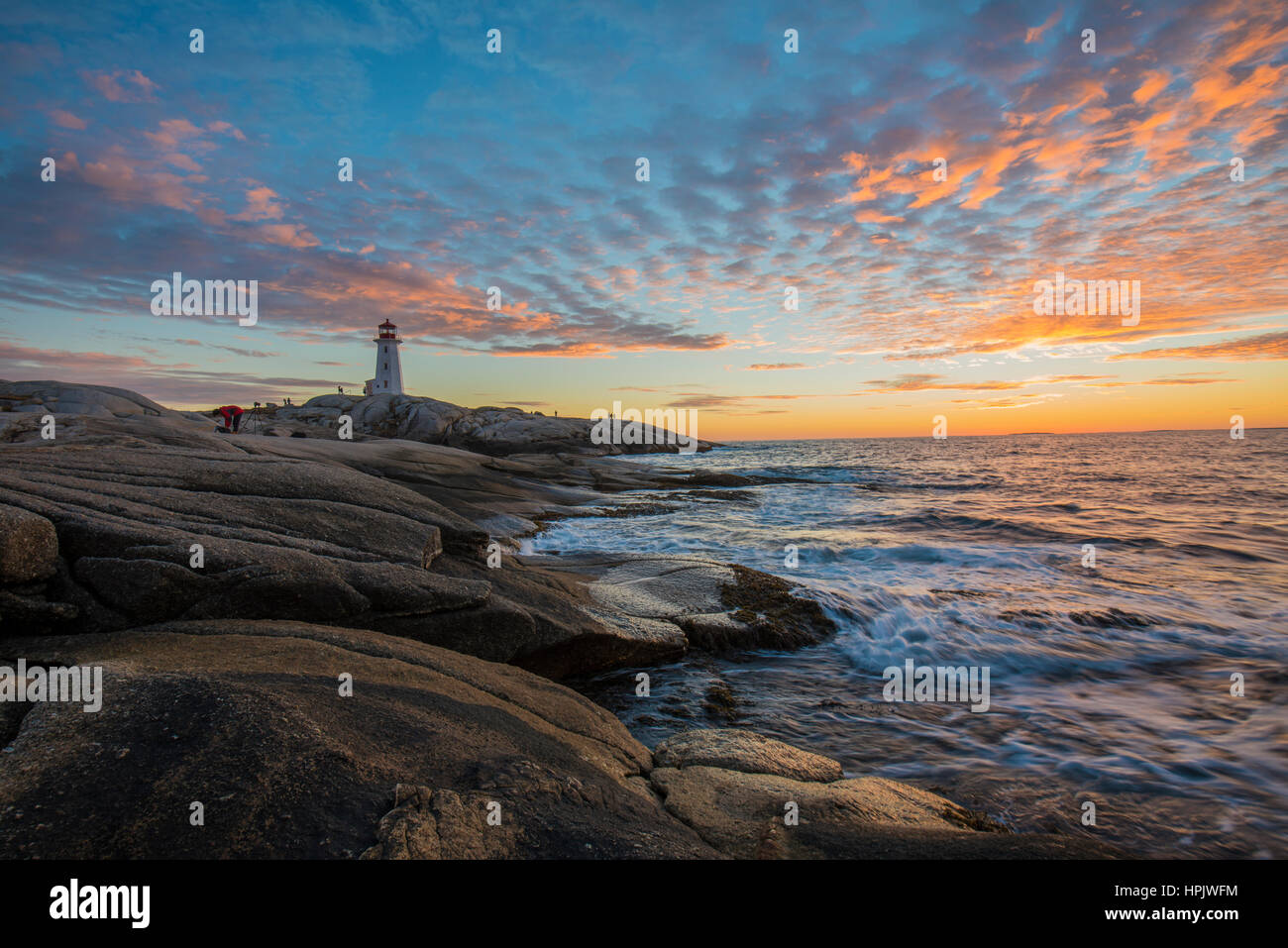 atlantic ocean peggy s cove rock and stone beach sunset landscape in