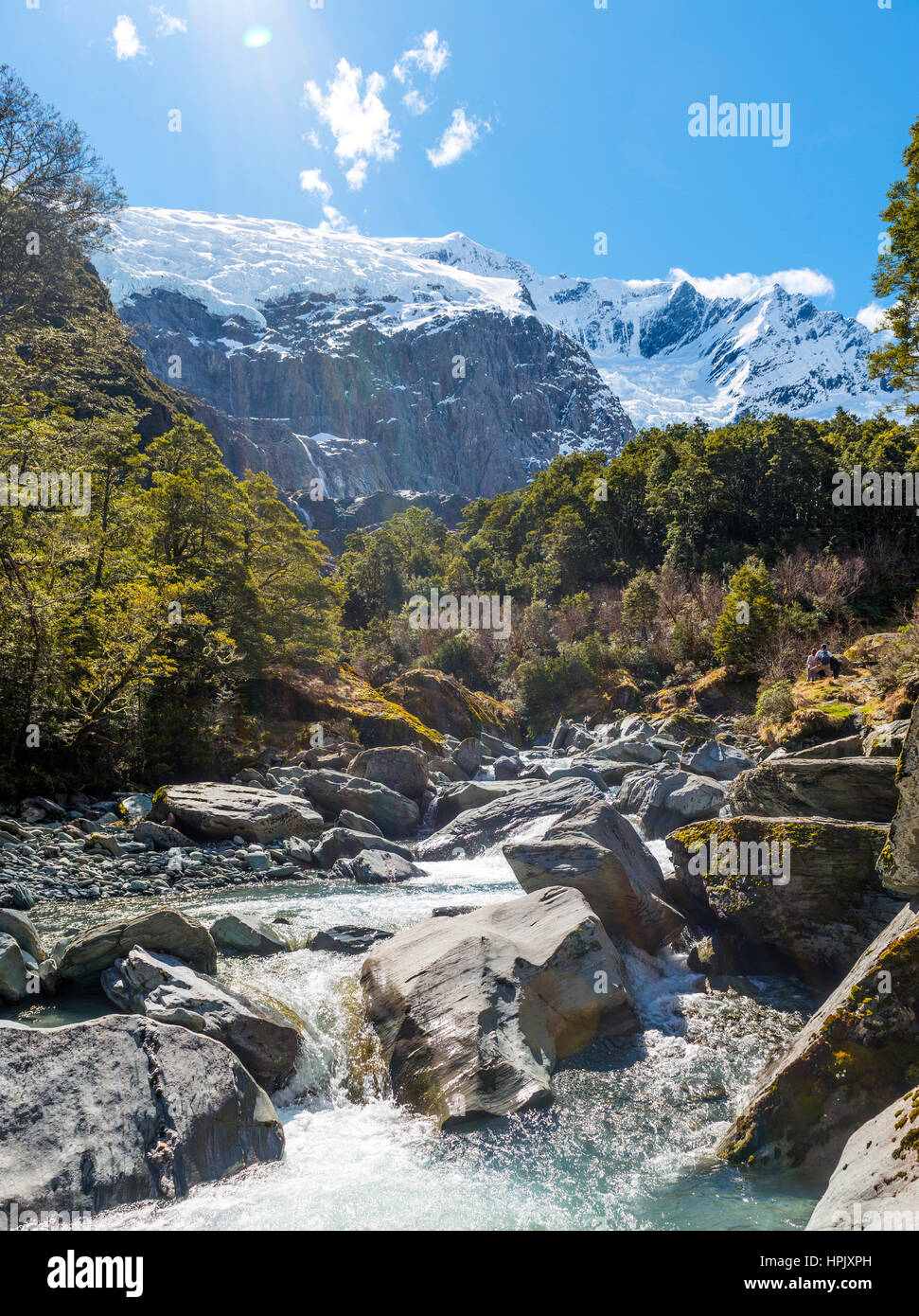 Glacial river flowing through mountains, Rob Roy Glacier, Mount Aspiring National Park, Otago, Southland, New Zealand - Stock Image