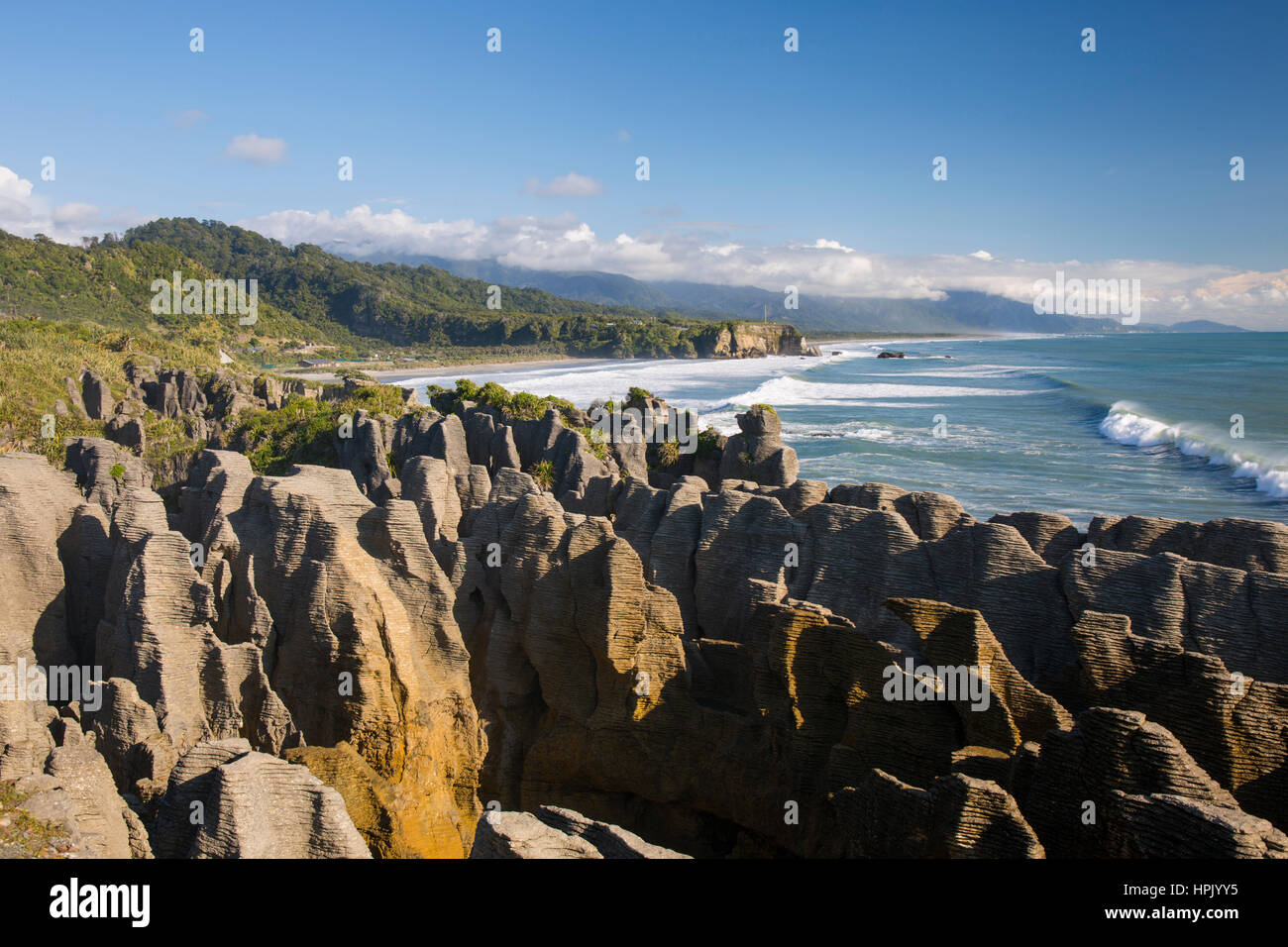 Punakaiki, Paparoa National Park, West Coast, New Zealand. View over Pancake Rocks and the Tasman Sea coast from - Stock Image
