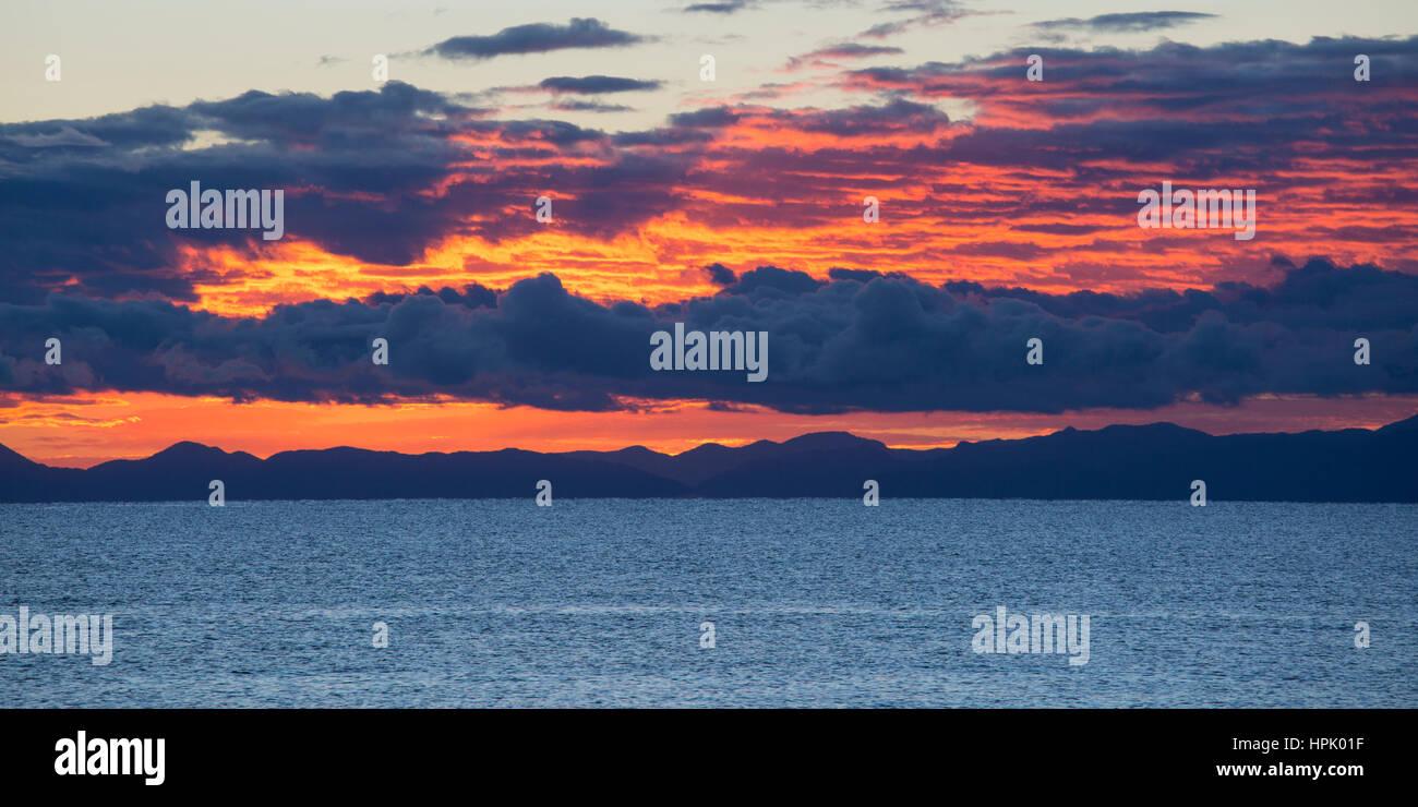 Marahau, Tasman, New Zealand. Panoramic view across Tasman Bay to the Nelson coastline and hills of the Bryant Range, - Stock Image