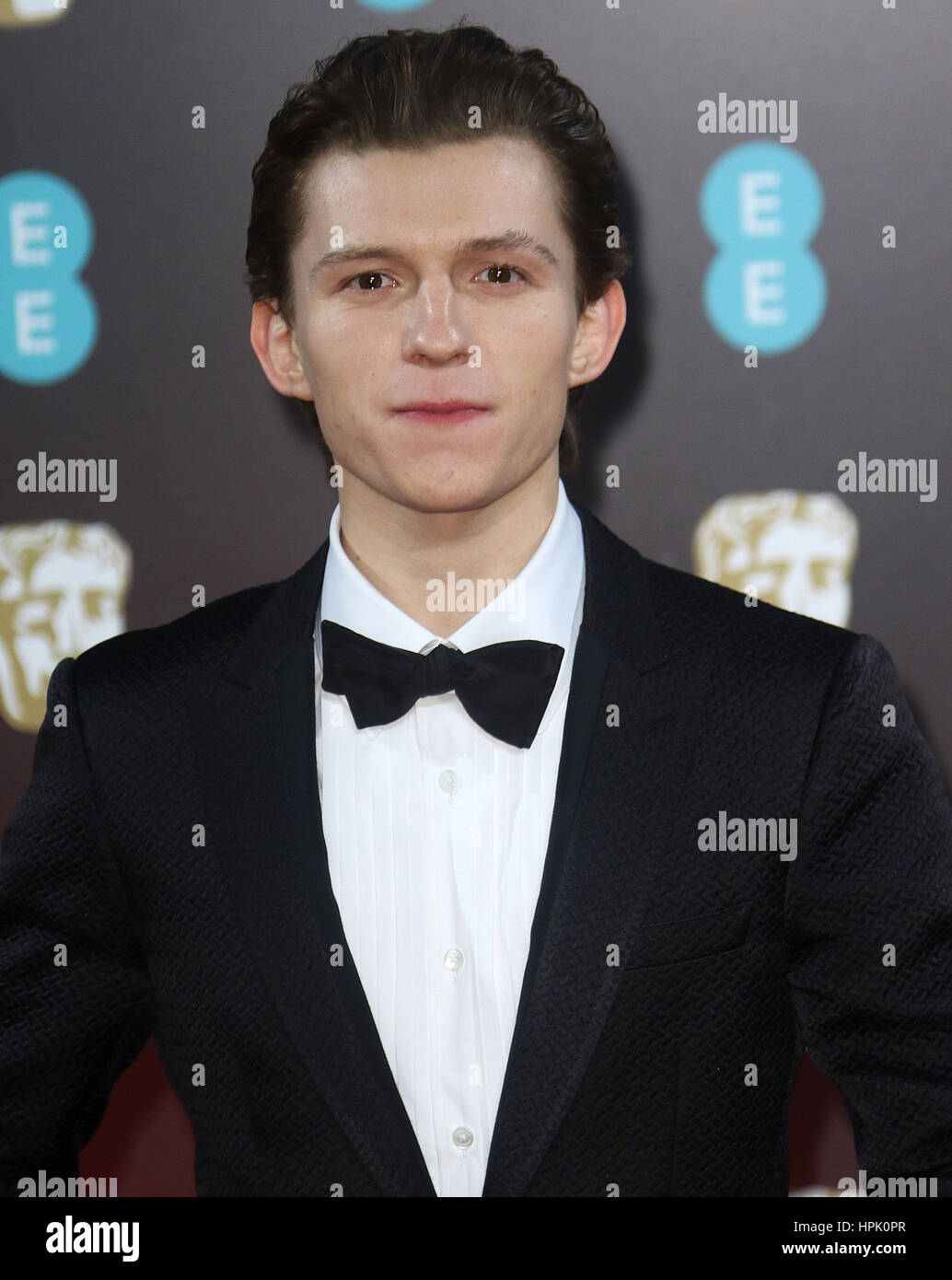 Feb 12, 2017  - Tom Holland attending EE British Academy Film Awards 2017 at Royal Opera House in London, England, - Stock Image