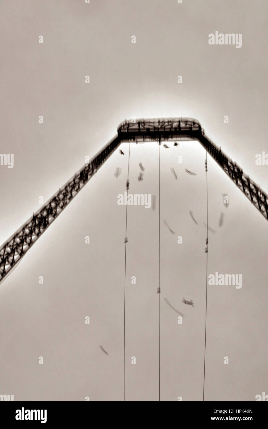 Movement of starlings against metal structure - Stock Image