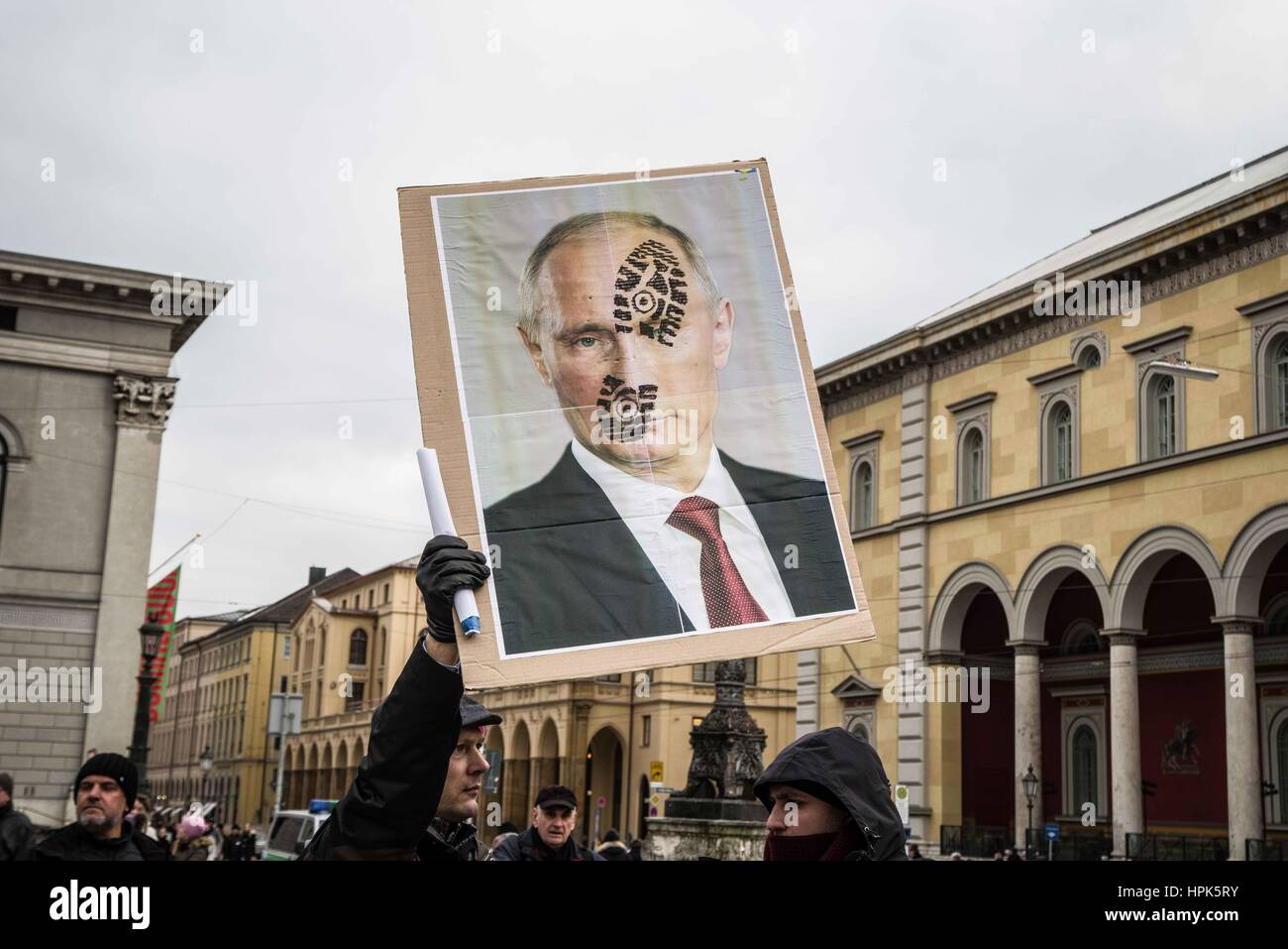 Munich, Germany. 18th Feb, 2017. Putin face with boot print. Anti-MSC protests organized by far- and radical-rightists - Stock Image
