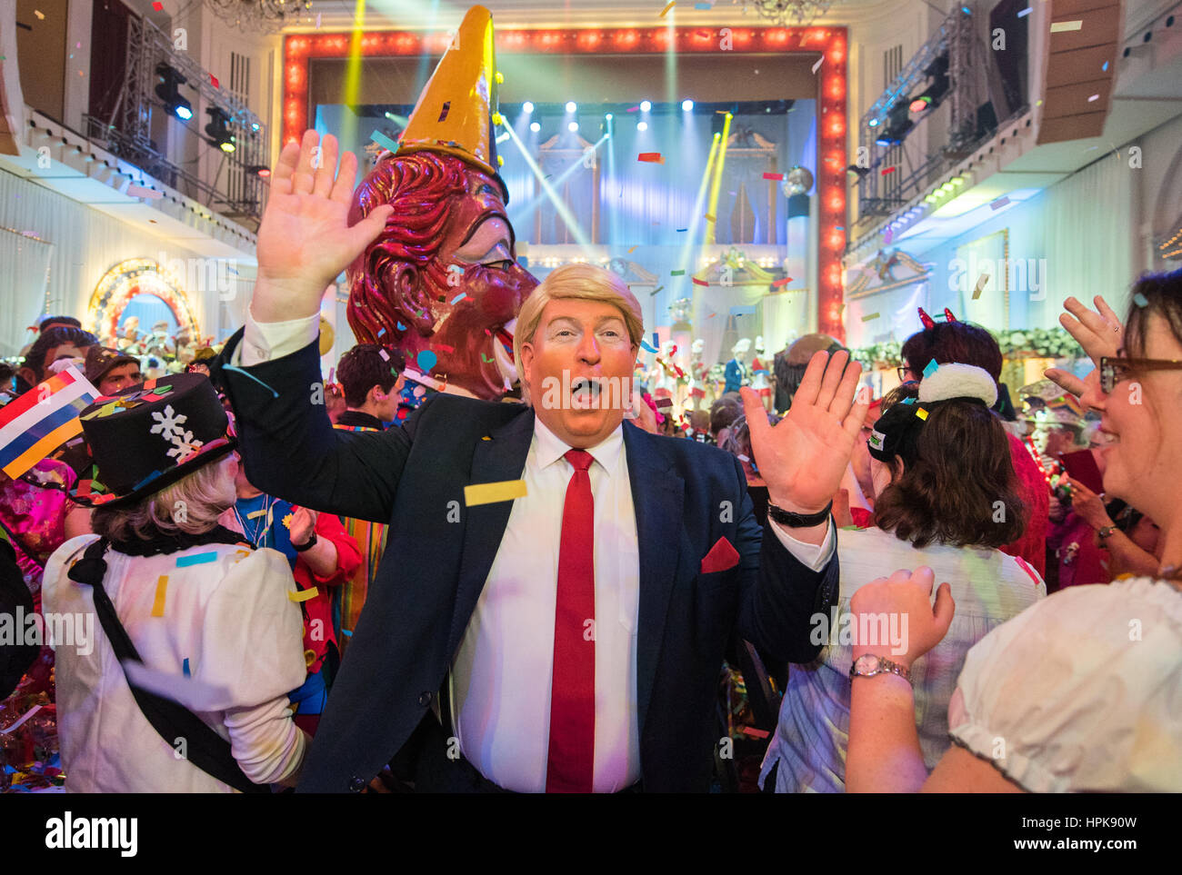 Frank Brunswig dressed as US President Donald Trump greets the audience during the general rehearsal for the Carnival Stock Photo